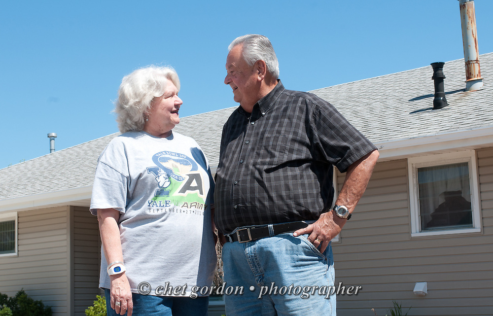 Ron and Evelyn Colvin outside their Waretown, NJ beach house on Sunday, August 7, 2014. Their home was severely damaged after Hurricane Sandy in 2012. They hired a contractor for repairs who did shoddy work and never completed the job, leaving the house unusable. They finally were able to hire a second contractor through Angie's List  (Bob Caccamo, owner of Sure Thing Home Remodeling) to re-do everything, including sheetrock, trim, moldings, wainscoting, tile, paint door installation and extensive work to their master bathroom. Caccamo finished the work in record time and at a fair price.  © Chet Gordon for Angie's List
