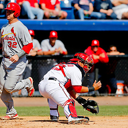 Mar 8, 2013; Melbourne, FL, USA; St. Louis Cardinals catcher Rob Johnson (32) scores on a single by Greg Garcia (not pictured) during the top of the third inning of a spring training game against the Washington Nationals at Space Coast Stadium. Mandatory Credit: Derick E. Hingle-USA TODAY Sports