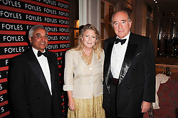 Left to right, SAM HUSAIN CEO of Foyles, CHRISTOPHER FOYLE and his wife CATHERINE at a gala dinner in celebration of 80 years since the first Foyles Literary Luncheon, held in The Ball Room, Grosvenor House Hotel, Park Lane, London on 21st October 2010.