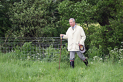 Charles and Camilla,  HRH The Prince Of Wales and HRH The Duchess of Cornwall visit The Wiltshire Wildlife Trust and Clattinger Farm near Oaksey, Wiltshire.<br /> Prince Charles walked through the wild flower meadows and met up with Camilla at the farm where they planted some orchids.<br /> Photo Ian Jones