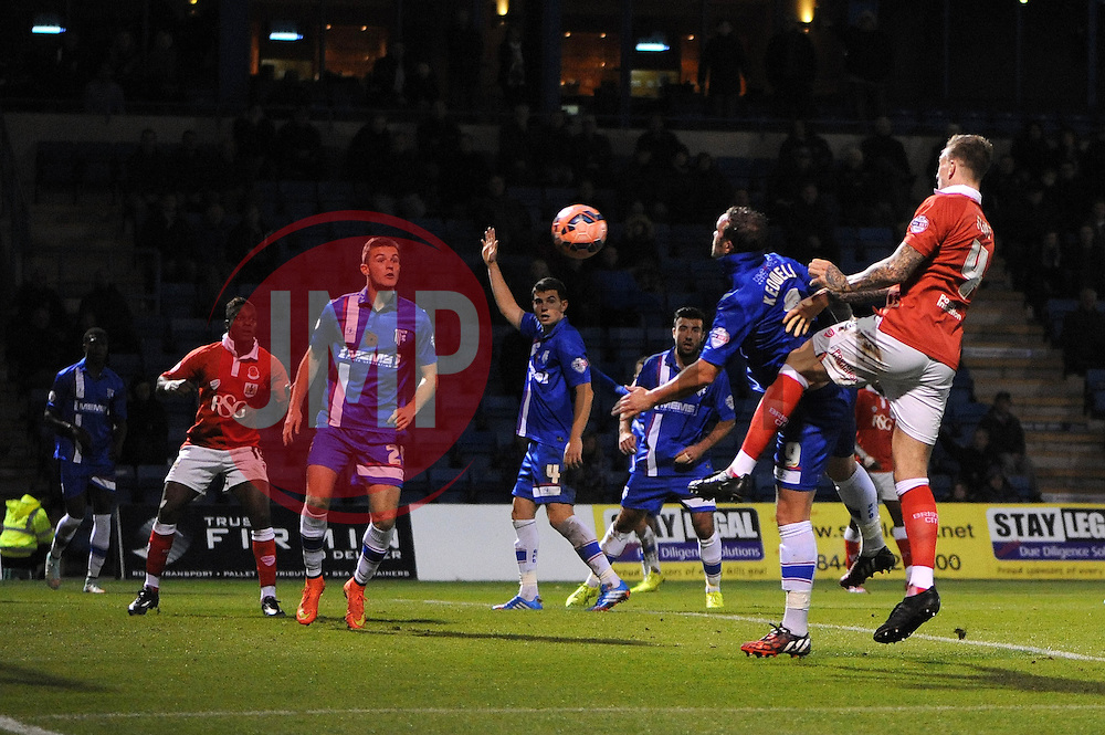 Bristol City's Aden Flint heads towards goal - Photo mandatory by-line: Dougie Allward/JMP - Mobile: 07966 386802 - 08/11/2014 - SPORT - Football - Gillingham - Priestfield Stadium - Gillingham v Bristol City - FA Cup - Round One