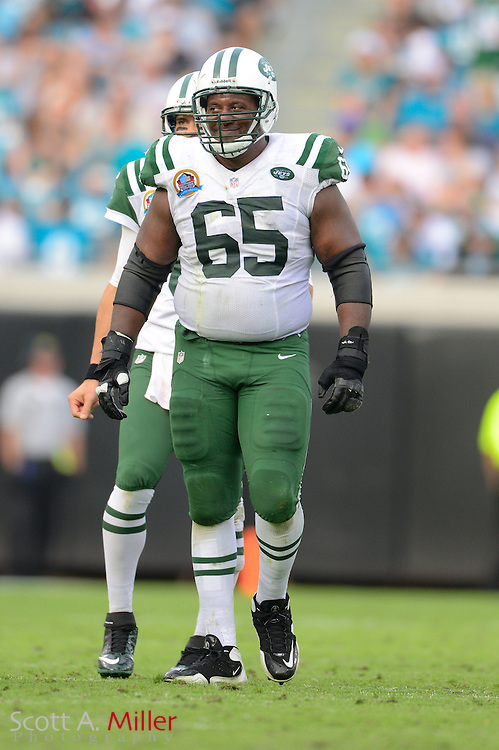 New York Jets guard Brandon Moore (65) during an NFL game against the Jacksonville Jaguars at EverBank Field on Dec 9, 2012 in Jacksonville, Florida. The Jets won 17-10...©2012 Scott A. Miller..