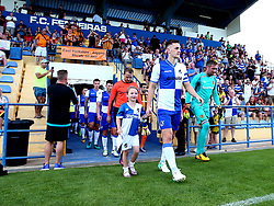 Tom Lockyer of Bristol Rovers and the mascot lead the teams out - Mandatory by-line: Robbie Stephenson/JMP - 18/07/2017 - FOOTBALL - Estadio da Nora - Albufeira,  - Hull City v Bristol Rovers - Pre-season friendly