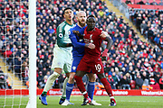 Liverpool striker Sadio Mane (10) Cardiff City goalkeeper Neil Etheridge (1) and Cardiff City midfielder Aron Gunnarsson (17) during the Premier League match between Liverpool and Cardiff City at Anfield, Liverpool, England on 27 October 2018.