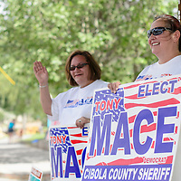 060314      Cayla Nimmo<br /> <br /> Nadine Rodriguez and Marcia Torres hold signs for Tony Mace on High Street for voters in Grants Tuesday afternoon.