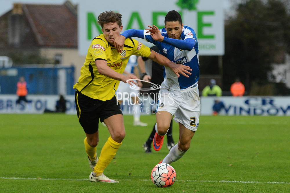 Bristol Rovers defender Daniel Leadbitter and Chesham United midfielder Sam Youngs battle during the The FA Cup match between Bristol Rovers and Chesham FC at the Memorial Stadium, Bristol, England on 8 November 2015. Photo by Alan Franklin.