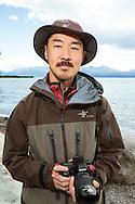 Wildlife photographer Takeshi Hanatani by the Skilak Lake, Alaska, USA.