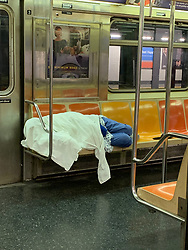 homeless person on the New York Subway