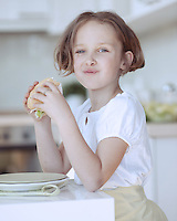 Beautiful Young Girl eating sandwich