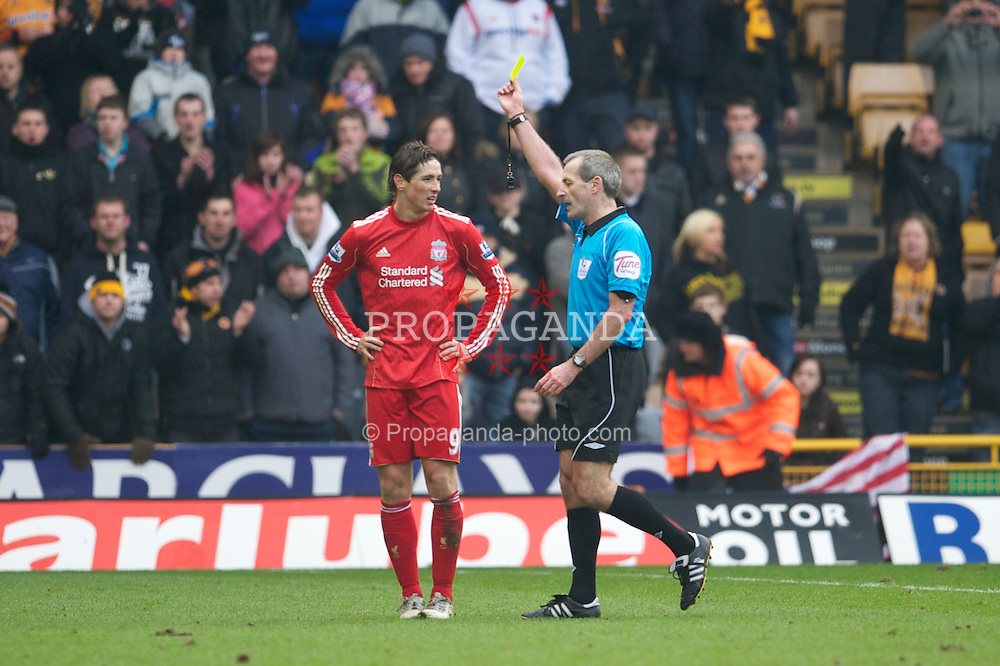WOLVERHAMPTON, ENGLAND - Saturday, January 22, 2011: Liverpool's Fernando Torres is shown the yellow card by referee Martin Atkinson during the Premiership match against Wolverhampton Wanderers at Molineux. (Photo by David Rawcliffe/Propaganda)