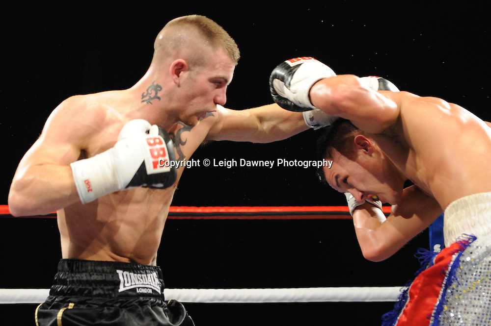 Josh Warrington (silver shorts) v Dougie Curran in a 4x3 Featherweight contest at the Premier Suite, Reebok Stadium, Bolton, UK on 22.10.11. Frank Maloney Promotions. Photo credit: © Leigh Dawney.