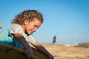 A Palestinian girl plays on a slide in Susiya, oblivious to the fact that it may soon be demolished along with the rest of the village.