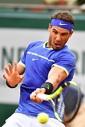 PARIS, June 2, 2017  Rafael Nadal of Spain returns the ball to Nikoloz Basilashvili of Georgia during the men's singles 3rd round match at the French Open Tennis Tournament 2017 in Paris, France on June 2, 2017. (Credit Image: © Chen Yichen/Xinhua via ZUMA Wire)