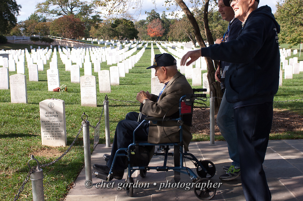A WWII Veteran views Audie Murphy's gravesite in Arlington National Cemetery in Arlington, VA on Saturday, October 18, 2014. Murphy was WWII's most decorated soldier. Seventy-five veterans from the Westchester County (NY) area toured the WWII Memorial and Arlington National Cemetery on the inaugural flight from Westchester County Airport in White Plains, NY. Hudson Valley Honor Flight is a chapter of the Honor Flight Network, which provides free flights for WWII Veterans and tours of the WWII Memorial constructed in their honor, and other sites in the nation's capital.  © www.chetgordon.com