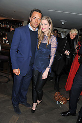 JAMES MIDDLETON and KATIE READMAN at the Beulah AW13 Showcase, Bungalow 8 LFW Pop-Up at Belgraves - A Thompson Hotel, 20 Chesham Place, London SW1 on 13th February 2013.