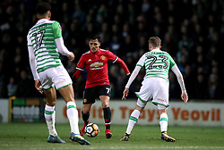 Manchester United's Alexis Sanchez (centre) during the Emirates FA Cup, fourth round match at Huish Park, Yeovil.