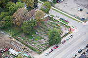 """""""Created in the spring of 2009, the North Cass Community Garden is located on the southwest corner of Second Avenue and Willis Street in the North Cass neighborhood. The 0.37 acre garden was built on 3 adjoining blighted parcels of property.  The garden offers seventy-five individual 4'x8' raised garden plots, ten 8'x12' restaurant/commercial raised beds, and six 4'x4' ADA (Americans with Disabilities Act) accessible raised garden beds all available to neighborhood residents and businesses to rent each growing season. JJR (now SmithGroupJJR) of Ann Arbor was chosen as the landscape engineers who designed the garden site without charge through their Employee Volunteer Program (EVP).  Many of the area residents participated in the planning process and the actual construction of the garden. Thanks to the many contributors including The Kresge Foundation, First American Title Insurance Company, MGM Grand Casino Detroit, Landscape Forms, and the Colin Hubbell Memorial Fund, for providing funds and/or in-kind materials for this project."""" Source: Midtown Detroit, Inc. Website"""