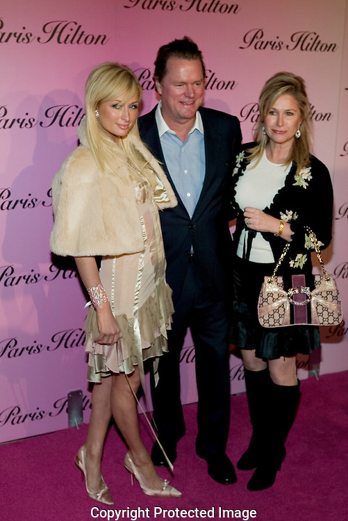 "Paris Hilton with her mother and father..Launch of ""Paris Hilton"" fragrance..5900 Wilshire Blvd..LA, CA US.12/3/04."