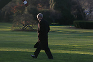 President George W. Bush walks from the Oval Office of the White House to Marine One on the first leg of his trip to Lima, Peru on November 21, 2008. Photograph by Dennis Brack