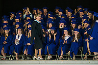 Keynote speaker Polly Rouhan is welcomed on stage by the class of 2017 during Gilford High School's 42nd commencement exercises at Meadowbrook on Saturday morning.  (Karen Bobotas/for the Laconia Daily Sun)