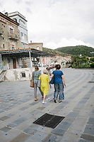 ACCIAROLI, ITALY - 14 SEPTEMBER 2018: Three women are seen here walking in Acciaroli, a small fishing village in the municipality of Pollica, Italy, on September 14th 2018.<br /> <br /> To understand how people can live longer throughout the world, researchers at University of California, San Diego School of Medicine have teamed up with colleagues at University of Rome La Sapienza to study a group of 300 citizens, all over 100 years old, living in Acciaroli (Pollica), a remote Italian village nestled between the ocean and mountains in Cilento, southern Italy.<br /> <br /> About 1-in-60 of the area's inhabitants are older than 90, according to the researchers. Such a concentration rivals that of other so-called blue zones, like Sardinia and Okinawa, which have unusually large percentages of very old people. In the 2010 census, about 1-in-163 Americans were 90 or older.