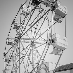 Ferris Wheel in Newport Beach California black and white photo. The Ferris Wheel at the Balboa Fun Zone is a popular attraction in Orange County in Southern California.