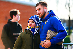 Josh Barrett of Bristol Rovers has his photo taken with a young Bristol Rovers fan - Mandatory by-line: Ryan Crockett/JMP - 18/01/2020 - FOOTBALL - Aesseal New York Stadium - Rotherham, England - Rotherham United v Bristol Rovers - Sky Bet League One