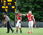 South Squad's Tim Ramstrom (right), from Natick High School, congratulates Nathan Harvey, from Newton North High School, during the Shriner's All-Star Football Classic at Bentley University in Waltham, June 22, 2018.   [Wicked Local Photo/James Jesson]