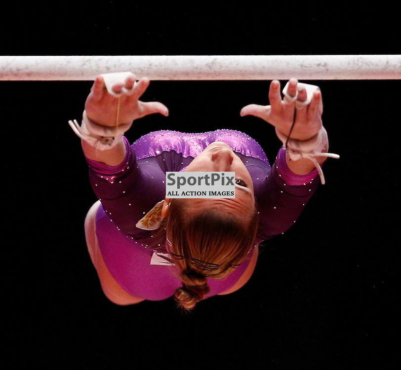 2015 Artistic Gymnastics World Championships being held in Glasgow from 23rd October to 1st November 2015.....Viktoriia Komova (Russia) performs on the Uneven Bars on Day 1 of the Women's & Men's Apparatus Final...(c) STEPHEN LAWSON | SportPix.org.uk