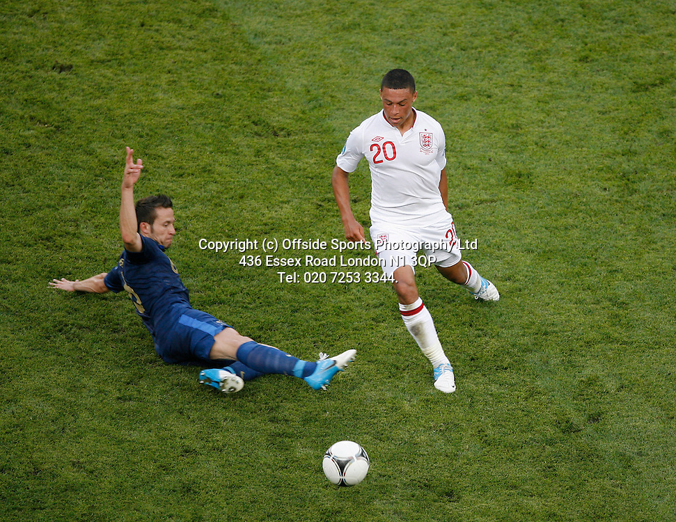 11/06/2012 European football championships. France v England.<br /> Alex Oxlade-Chamberlain goes past Yohann Cabaye.<br /> Photo: Mark Leech.