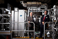 Daniel Layton and Donald Stevenson, Sept. 27, 2011 in Houston at a Stewart & Stevenson facility. They are standing in front of fracking equipment produced by their company. (Eric Kayne/For the Houston Business Journal)
