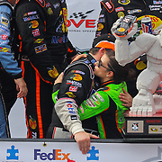 Danica Patrick (right) congratulates Tony Stewart in victory lane after Stewart wins the NASCAR SPRINT CUP SERIES FEDEX 400 BENEFITING AUTISM SPEAKS  at Dover International Speedway in Dover, DE., Sunday,  June 02, 2013.1