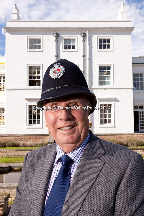 A Portrait of Ken Wells, Curator of Thames Valley Police Museum, who retires this year (2012) after a half century of service with the police. He is pictured with an original Berkshire Constabulary helmet and the photographs are taken through (and alongside) his own original MPP Large Format Plate Camera that he used whilst a SOCO.<br />  Ken started with the Metropolitan Police, before transferring to Berkshire Constabulary. He was originally a beat copper before becoming a Scenes of Crime Officer, as both a constable and then as a member of police staff. On reitrement, Ken became curator of the museum based at Sulhamstead. Sulhamstead, UNITED KINGDOM. September 13 2012. <br /> Photo Credit: MDOC/Thames Valley Police<br /> &copy; Thames Valley Police 2012. All Rights Reserved. See instructions.