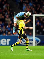 Manchester City's Pablo Zabaleta battles for the high ball with Borussia Dortmund's Robert Lewandowski - Photo mandatory by-line: Joe Meredith/JMP  - Tel: Mobile:07966 386802 03/10/2012 - Manchester City v Borussia Dortmund - SPORT - FOOTBALL - Champions League -  Manchester   - Etihad Stadium -