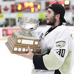 TRENTON, ON - Apr 22, 2016 -  Ontario Junior Hockey League game action between Trenton Golden Hawks and the Georgetown Raiders. Game 5 of the Buckland Cup Championship Series  at the Duncan Memorial Gardens in Trenton, Ontario. Daniel Urbani #30 of the Trenton Golden Hawks hoists the Buckland Cup.<br /> (Photo by Tim Bates / OJHL Images)