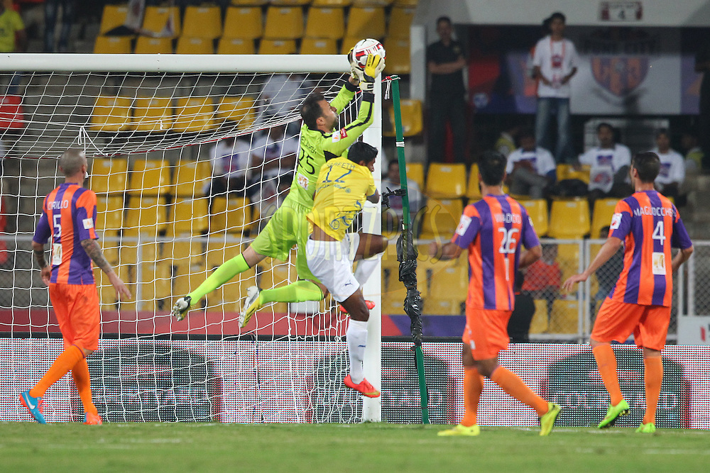 FC Pune City goalkeeper Emanuele Belardi claims the ball from CS Sabeeth of Kerala Blasters FC during match 17 of the Hero Indian Super League between FC Pune City<br /> and Kerala Blasters FC held at the Shree Shiv Chhatrapati Sports Complex Stadium, Pune, India on the 30th October 2014.<br /> <br /> Photo by:  Ron Gaunt/ ISL/ SPORTZPICS