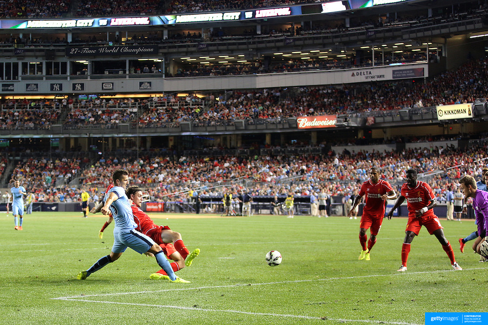 Stevan Jovetic, (left), Manchester City, scores his sides second goal during the Manchester City Vs Liverpool FC Guinness International Champions Cup match at Yankee Stadium, The Bronx, New York, USA. 30th July 2014. Photo Tim Clayton