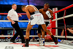Bob Ajisafe (white shorts, black trim) beats Daniel Wanyonyi (black shorts, white trim) by 4th round knock out in a bout for the vacant Commonwealth Light Heavweigt Title - Photo mandatory by-line: Rogan Thomson/JMP - 07966 386802 - 13/06/2015 - SPORT - BOXING - Bristol, England - Action Indoor Sports Arena - Lee Haskins vs Ryosuke Iwasa - Interim IBF World Bantamweight Title Fight - UNDERCARD.