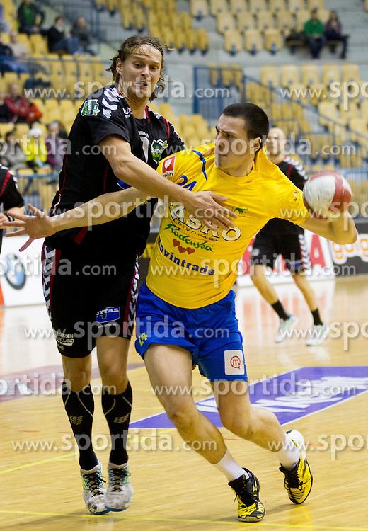 Jakob Thoustrup of Aarhus vs Nemanja Zelenovic of Celjeduring handball match between RK Celje Pivovarna Lasko and HC Aarhus Haandbold (DEN) in second leg match of  Last 16 of EHF Cup Winners' Cup, on February 18, 2012 in Arena Zlatorog, Celje, Slovenia. (Photo By Vid Ponikvar / Sportida.com)