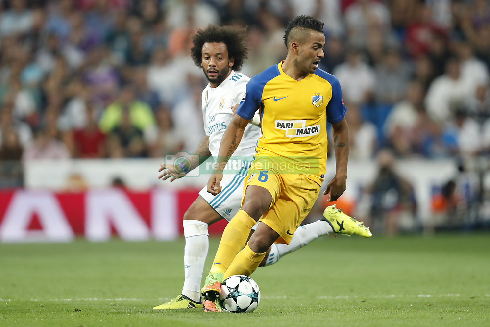 (L-R) Marcelo of Real Madrid, Lorenzo Ebecilio of APOEL FC during the UEFA Champions League group H match between Real Madrid and APOEL FC on September 13, 2017 at the Santiago Bernabeu stadium in Madrid, Spain.