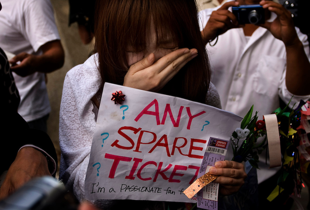 WILLIE J. ALLEN JR., | Times.OT_308790_ALLE_MJmemorial.(07/07/09 Tampa)  Akiko Seno, 25 (cq) of Japan sheds happy tears after she was given a ticket by someone with an extra ticket on his way into the Michael Jackson memorial show at the Staples Center  on Tuesday morning July 7, 2009 in Los Angeles.  After traveling all the way from Japan Seno was desperate and just standing in the crowd with her sign asking for a spare ticket for a passionate fan and an anonymous man walked up and gave her the ticket.  Jackson 50 died suddenly at UCLA Medical Center after going into cardiac arrest at the home he rented on June 25 in Los Angeles, California.[WILLIE J. ALLEN JR.,].