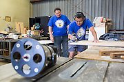 Milpitas Unified School District's Superintendent Cary Matsuoka, right, works with cabinet maker and carpenter Gary Walter on mobile work stations during the California School Employees Association Appreciating Classified Employees event throughout the Milpitas Unified School District in Milpitas, California, on May 21, 2015. (Stan Olszewski/SOSKIphoto)