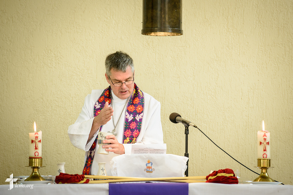 The Rev. Daniel Conrad, LCMS missionary to Mexico, consecrates the elements as he leads worship at the Lutheran Church of San Pedro on Sunday, Feb. 14, 2016, in Mexico City, Mexico. LCMS Communications/Erik M. Lunsford