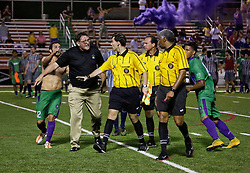 16 May 2015. New Orleans, Louisiana.<br /> National Premier Soccer League. NPSL. <br /> 2nd half. The New Orleans Jesters play Nashville FC at home in the Pan American Stadium. Jesters drew 1-1 with Nashville in a game that ended in a controversial equalizer from a free kick awarded to Nashville as the minutes wound down in extra time. Jesters head coach Kenny Farrell  has words with the referee and linesmen at the end of the game. <br /> Photo; Charlie Varley/varleypix.com