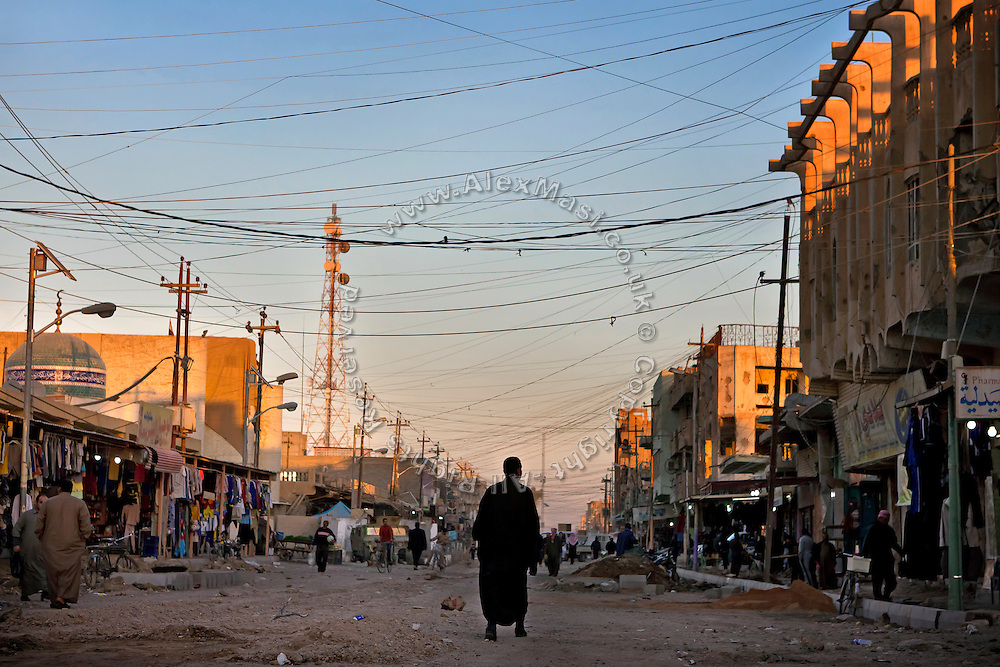 A man is walking on the streets of Fallujah, Iraq.