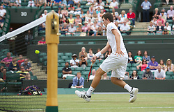 LONDON, ENGLAND - Sunday, July 3, 2011: Geroge Morgan (GBR) hits the winning match-point during the Boys' Doubles Final match on day thirteen of the Wimbledon Lawn Tennis Championships at the All England Lawn Tennis and Croquet Club. (Pic by David Rawcliffe/Propaganda)