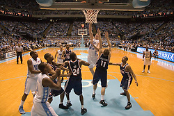 UNC's Tyler Hansbrough (50) hooks a shot over UVA's Laurynas Mikalauskas (11).   The #1 ranked Tar Heels beat the Cavaliers 79-69 to improved to 15-1 overall, 2-0 ACC on January 10, 2007 at the Dean Smith Center in Chapel Hill, NC.<br />