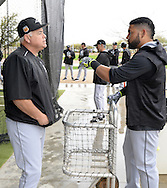 GLENDALE, ARIZONA - FEBRUARY 19:  Manager Rick Renteria #17 speaks with Melky Cabrera #53 of the Chicago White Sox during spring training workouts on February 19, 2017 at Camelback Ranch in Glendale Arizona.  (Photo by Ron Vesely). Subject:  Rick Renteria