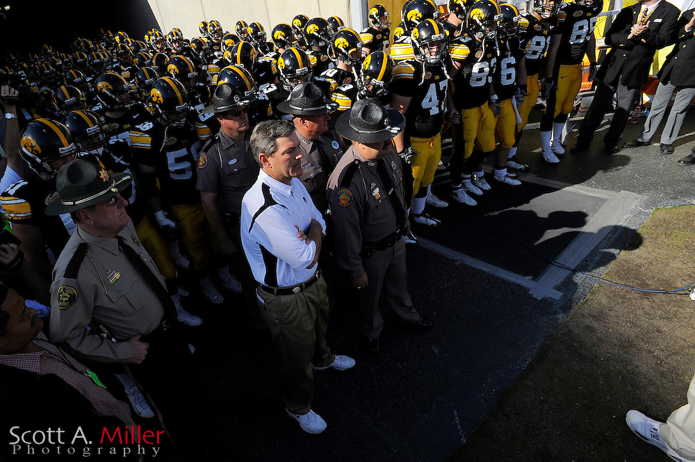 Jan 1, 2009; Tampa, FL, USA; Iowa Hawkeyes coach Kirk Ferentz and his team wait to take the field prior to the Outback Bowl against the South Carolina Gamecocks at the Raymond James Stadium ©2009 Scott A. Miller