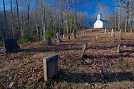 View of a historic white church from its cemetery, Great Smoky Mountains National Park